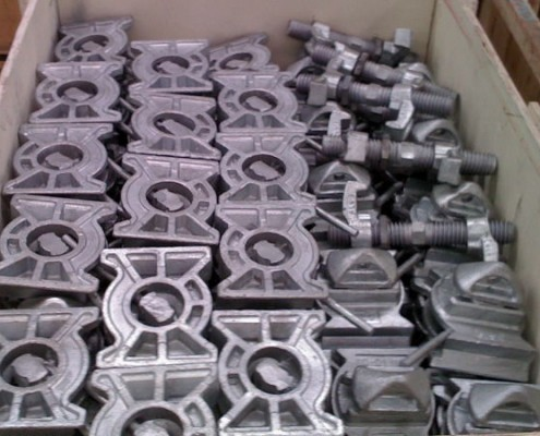 weldable twist locks and bridge clamps